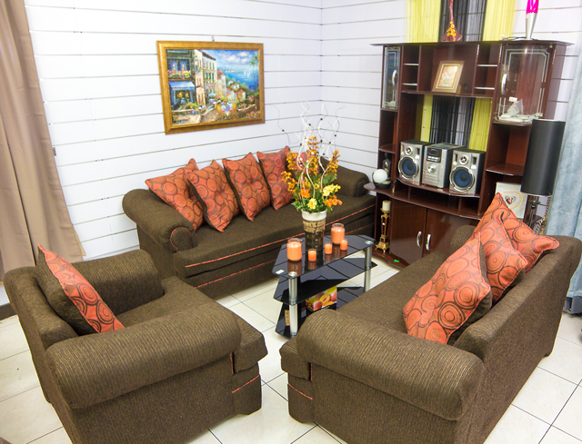 Living-room-setting-with-the-Sunflower-3-Piece-Brown-and-Burnt-Orange-Sofa-Set