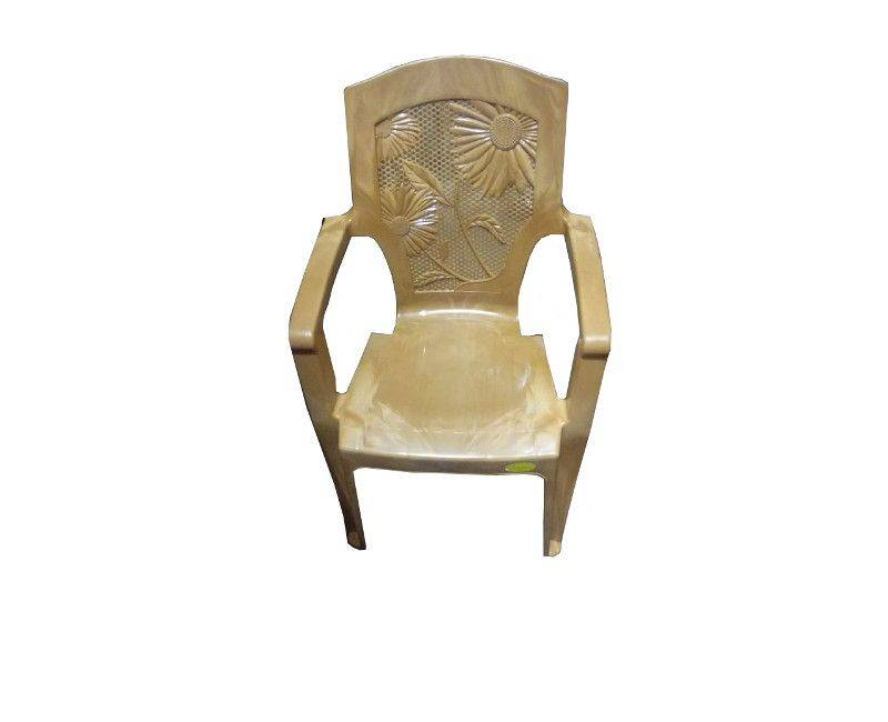 Tan colored floral back plastic chair with arm rests